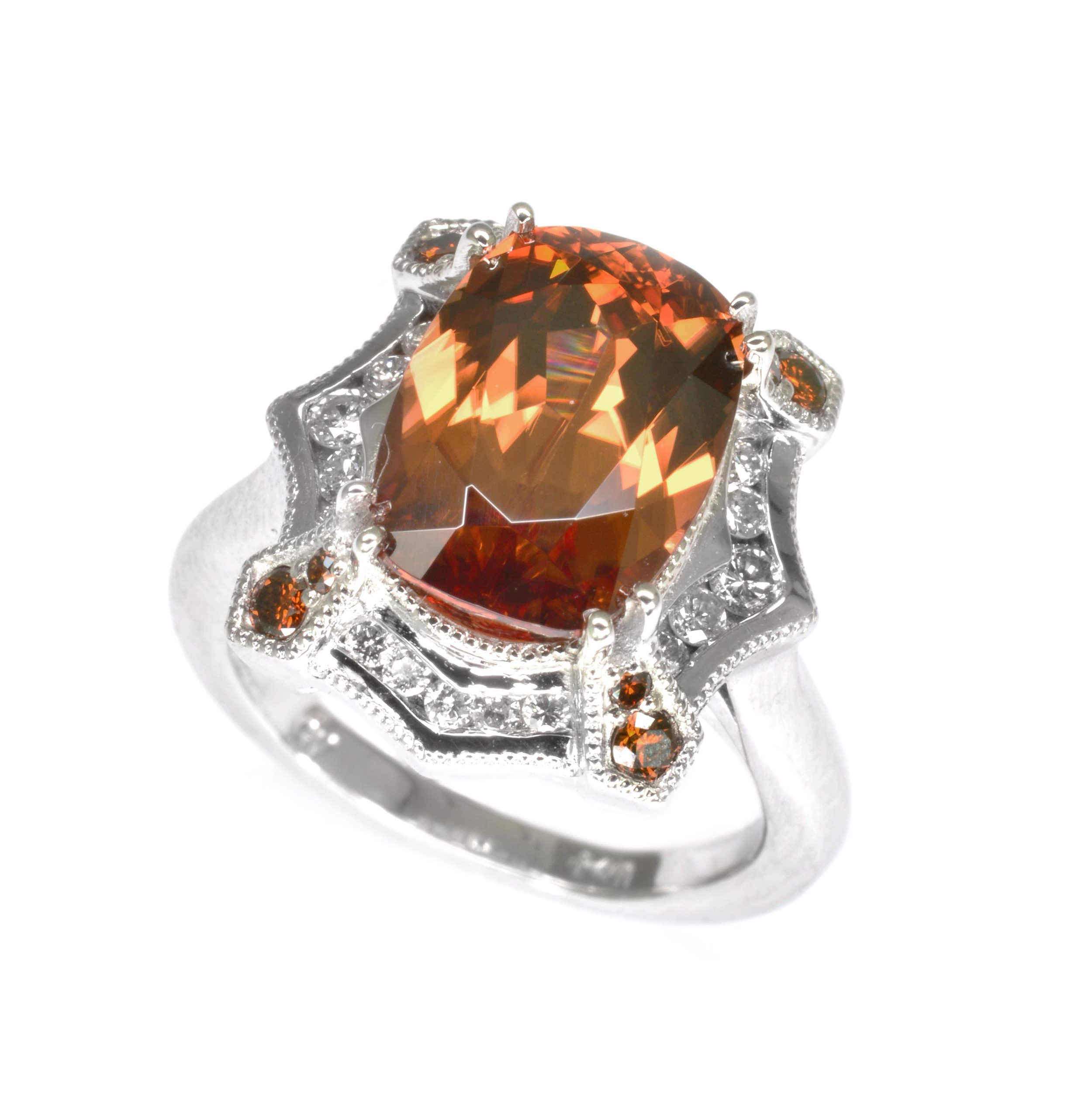 14k white gold ring set with a cinnamon zircon accented with channel set white diamonds and bead set cognac diamonds, designed by Jason Baskin.