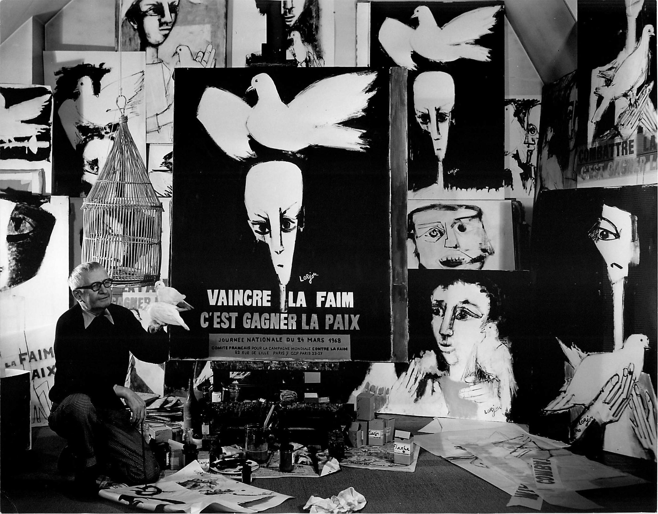 """Lorjou with his series and poster titled """"Combattre la faim c'est gagner la paix."""" (1968)"""