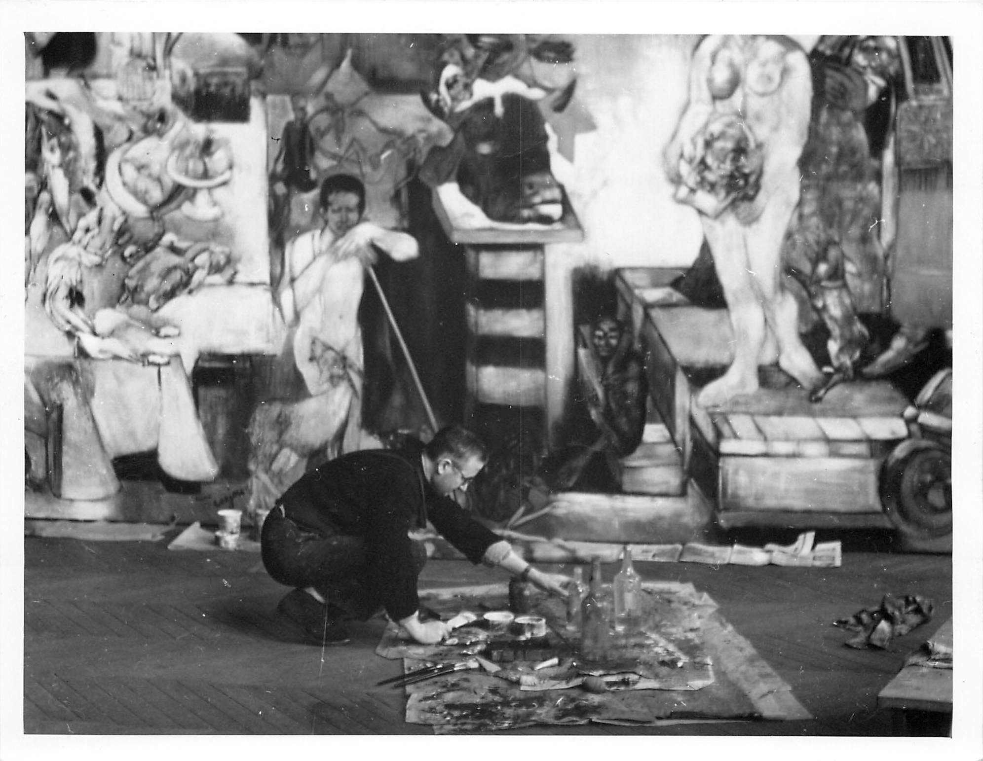 """Lorjou painting in front of his monumental painting """"L'Age Atomique"""""""