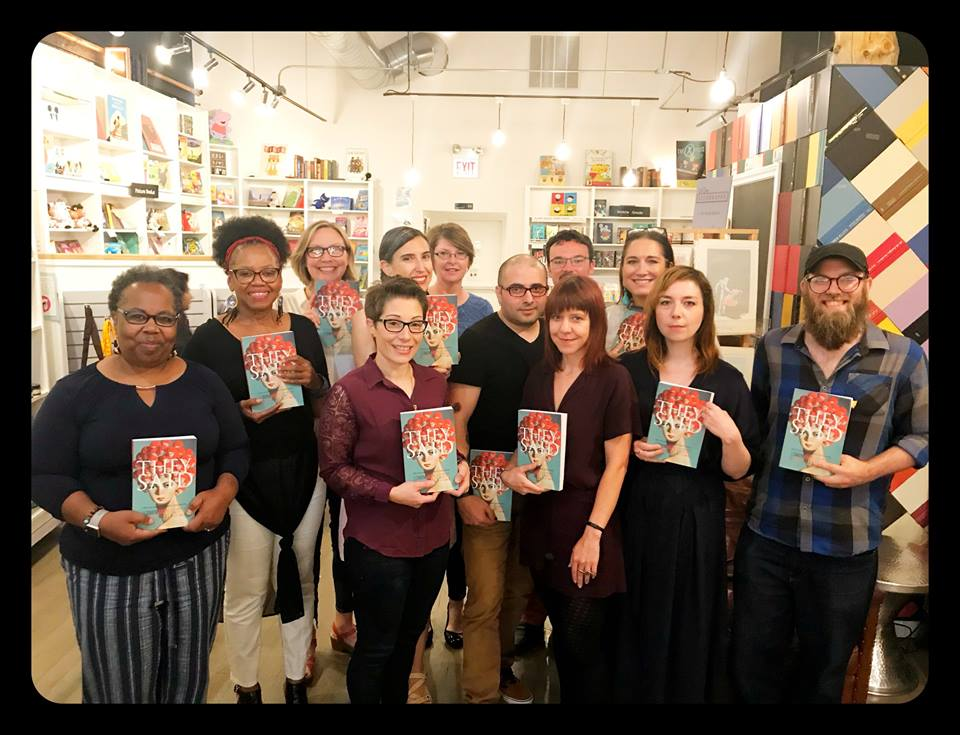 """Tina Bell (left end) holds a copy of """"They Said"""" anthology at Volumes Bookstore."""