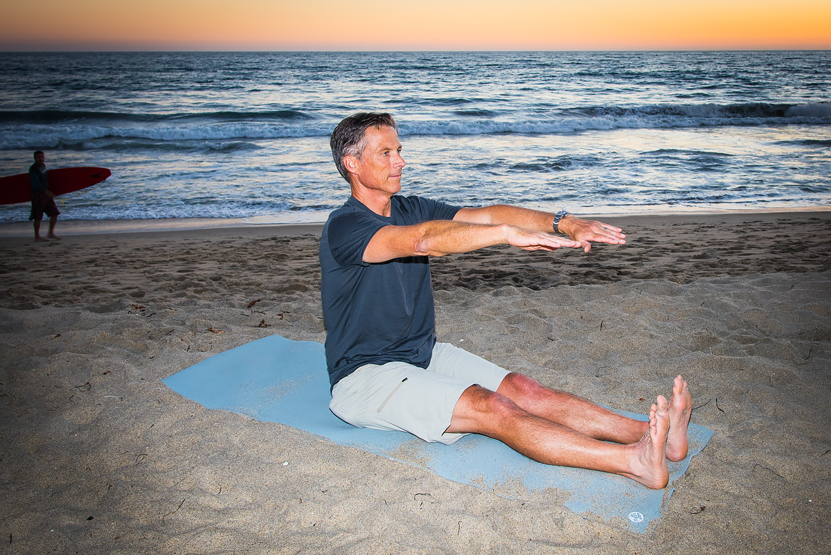 Yes, even surfers like Byron take time for a little Spine Stretch Forward on the beach.
