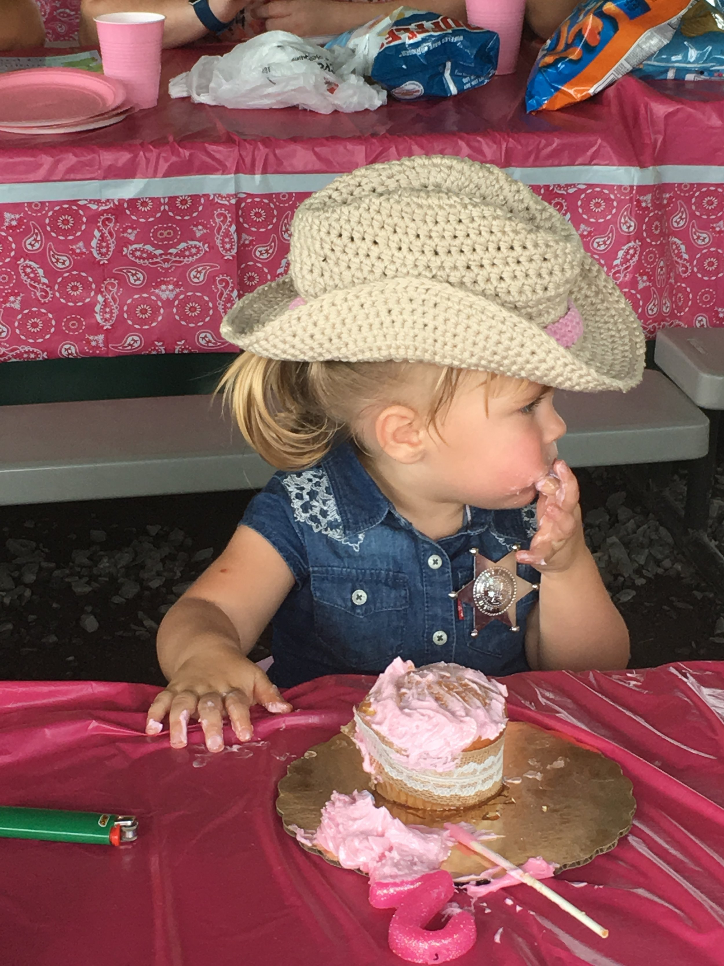 My granddaughter at her 2nd birthday party with a little cowgirl hat I made for her!