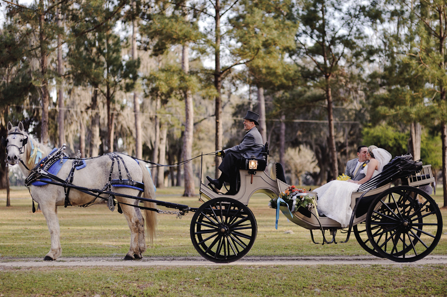 bride and groom with horse and carriage | santa fe ranch