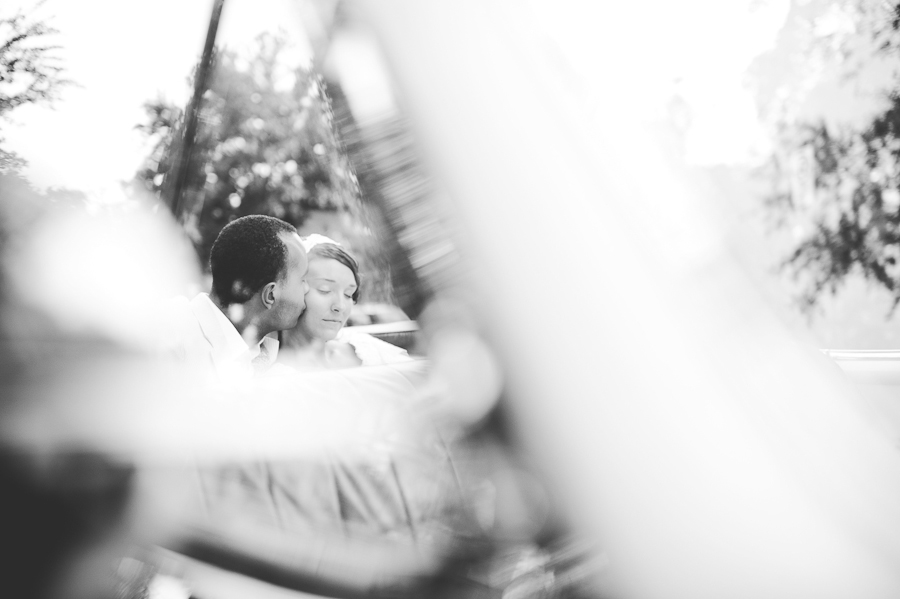 sunglow photography, bride and groom in the back seat of of antique convertible at wedding