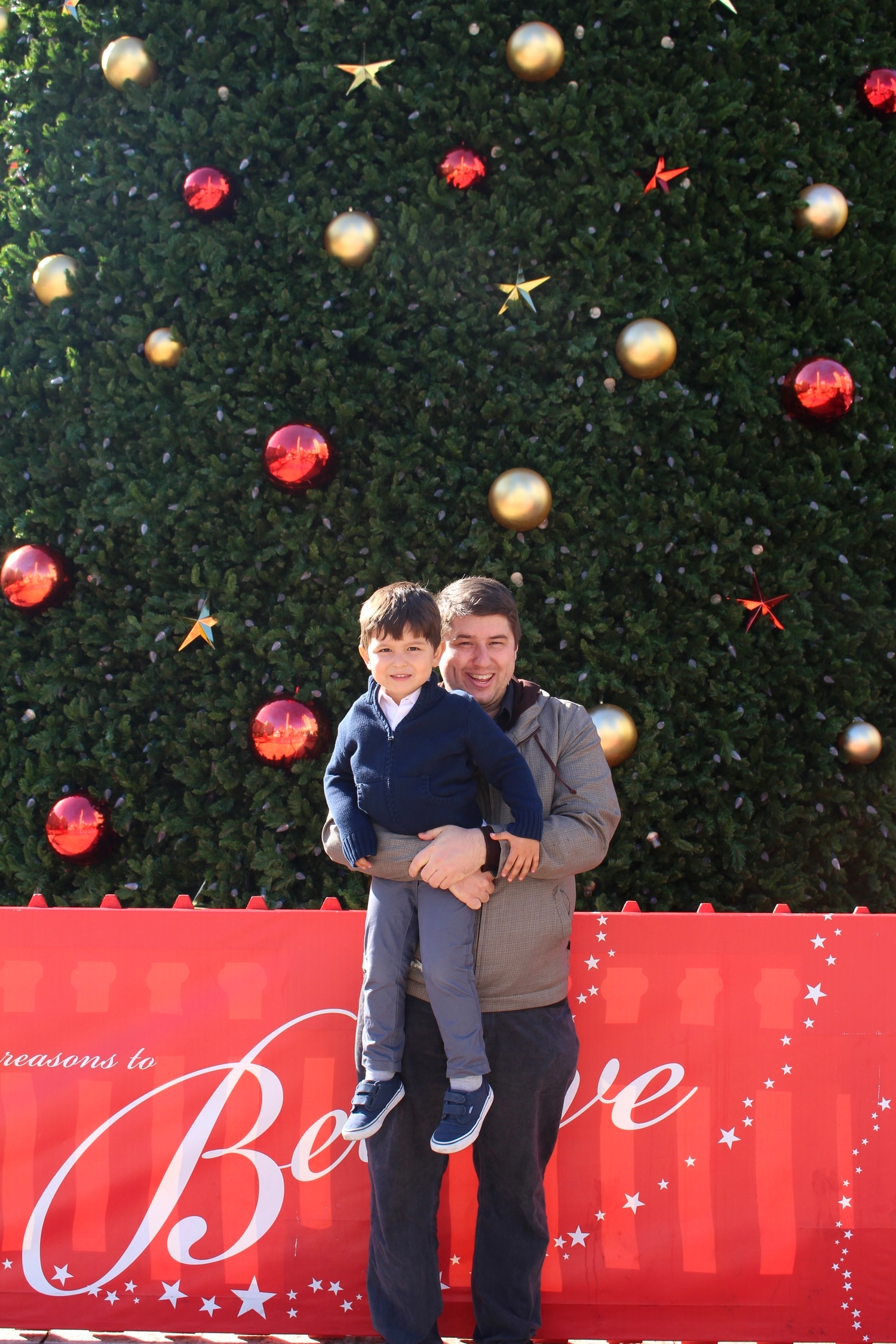Mark Jacinto and Papi at Union Square by the giant Christmas tree. Love youguys<3