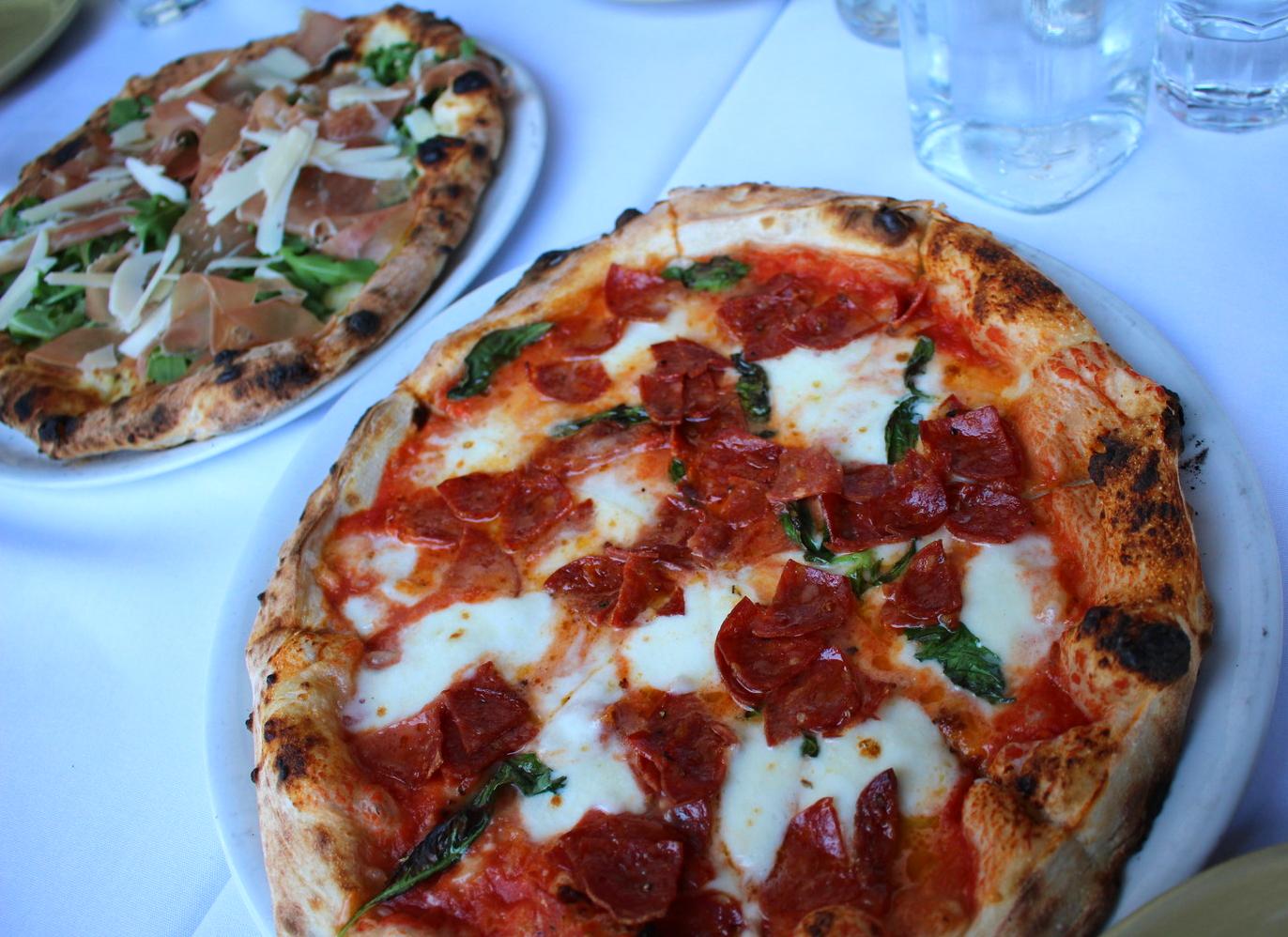 Diavolo pizza and prosciutto pizza.