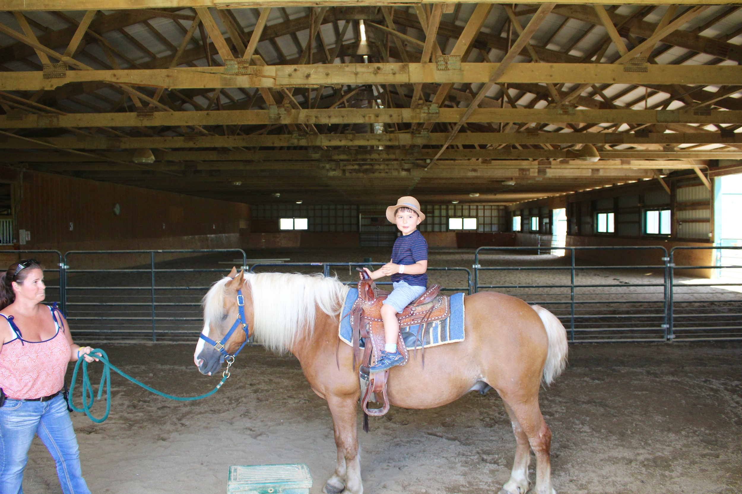 His first time riding a horse ^.^