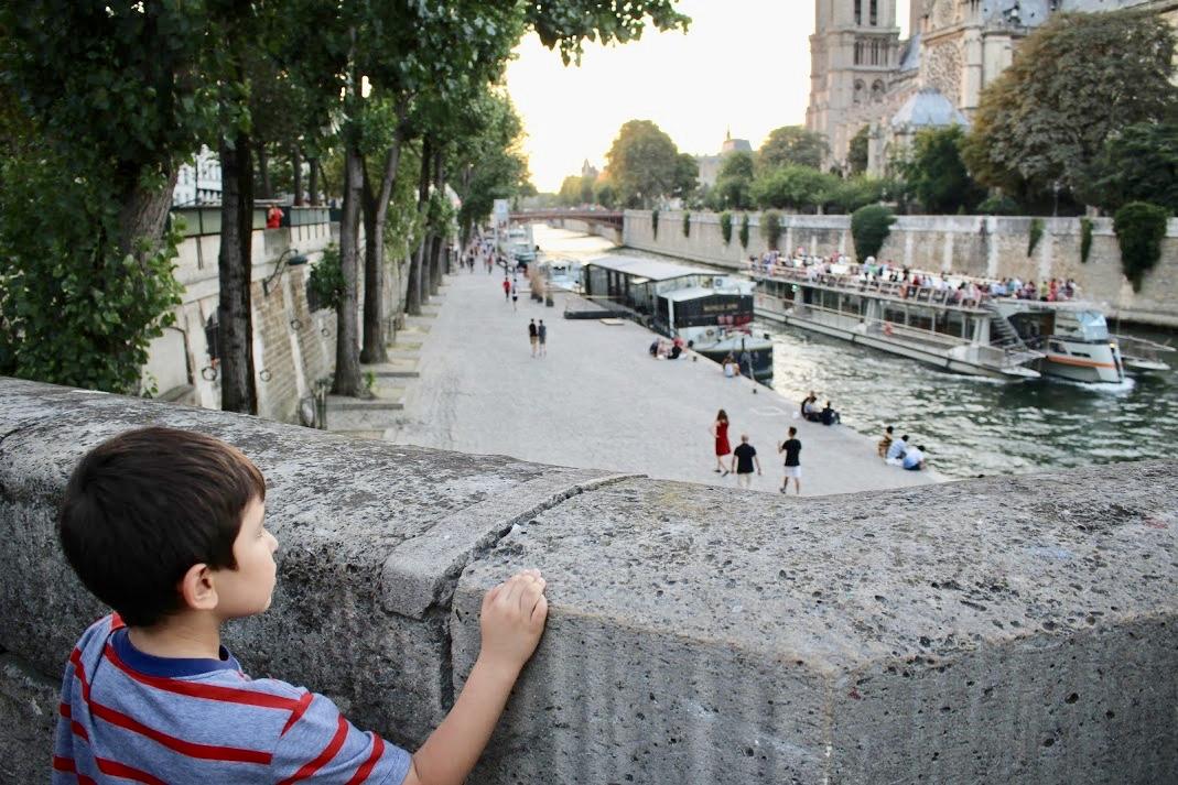 a kid pondering.