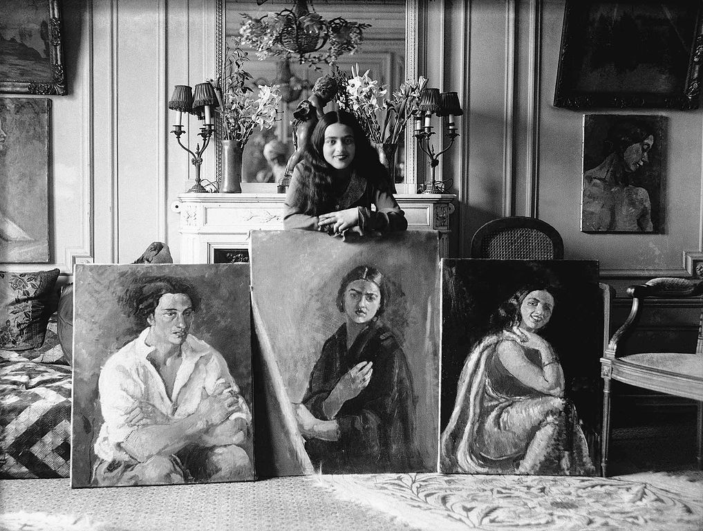 Amrita_Sher-Gil_with_3_paintings.jpg