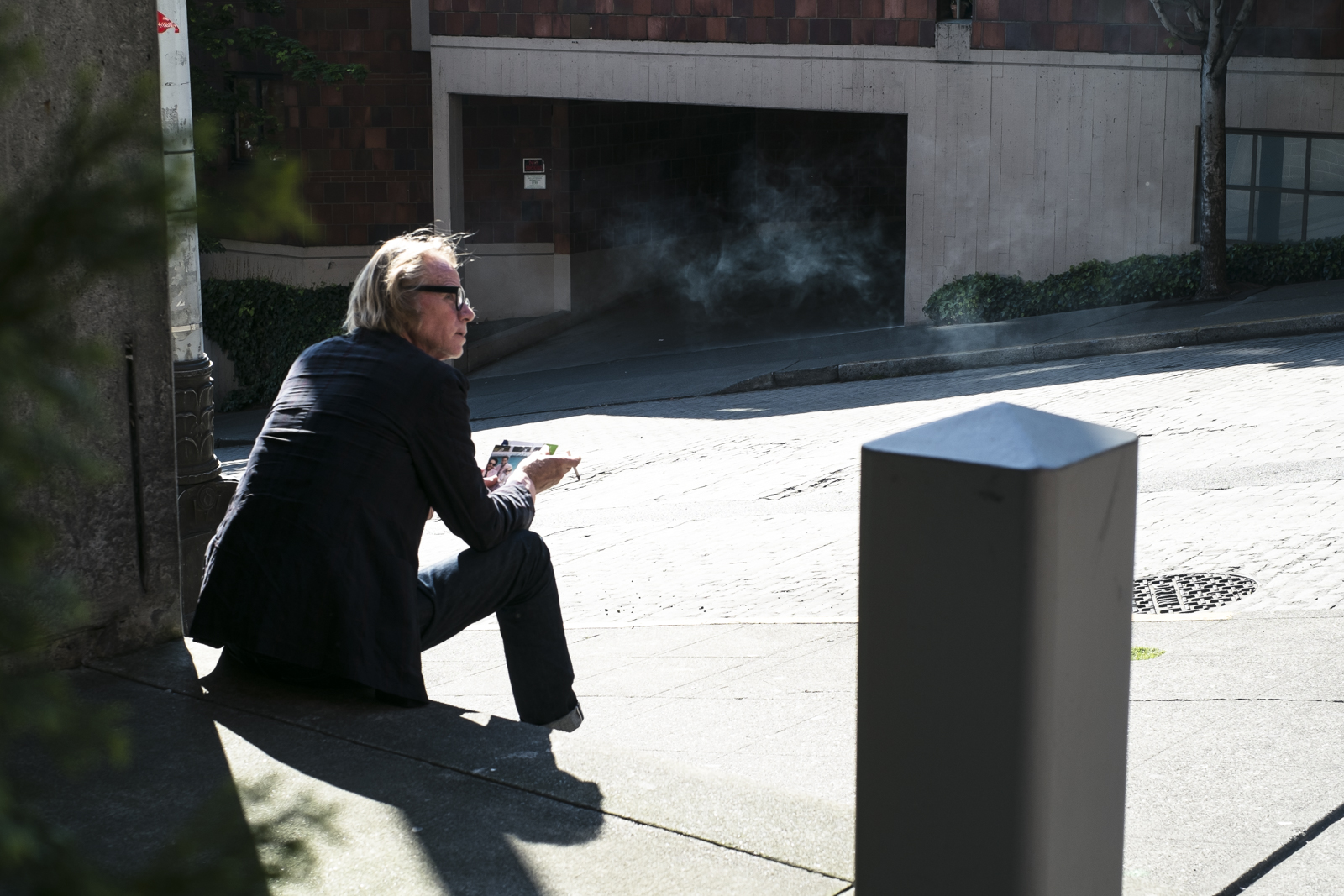 Smoking man     in Seattle, WA by photographer Dylan Priest