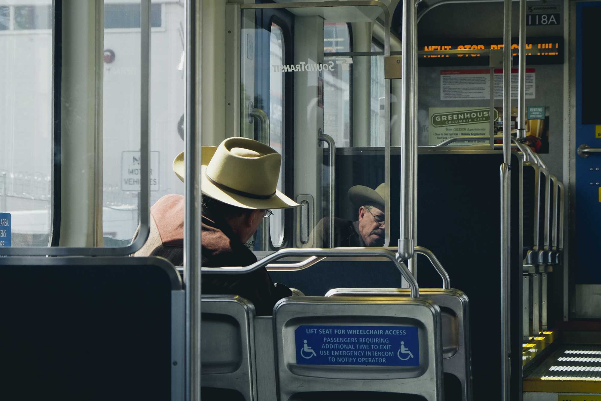 Riding the light rail   in Seattle, WA by photographer Dylan Priest