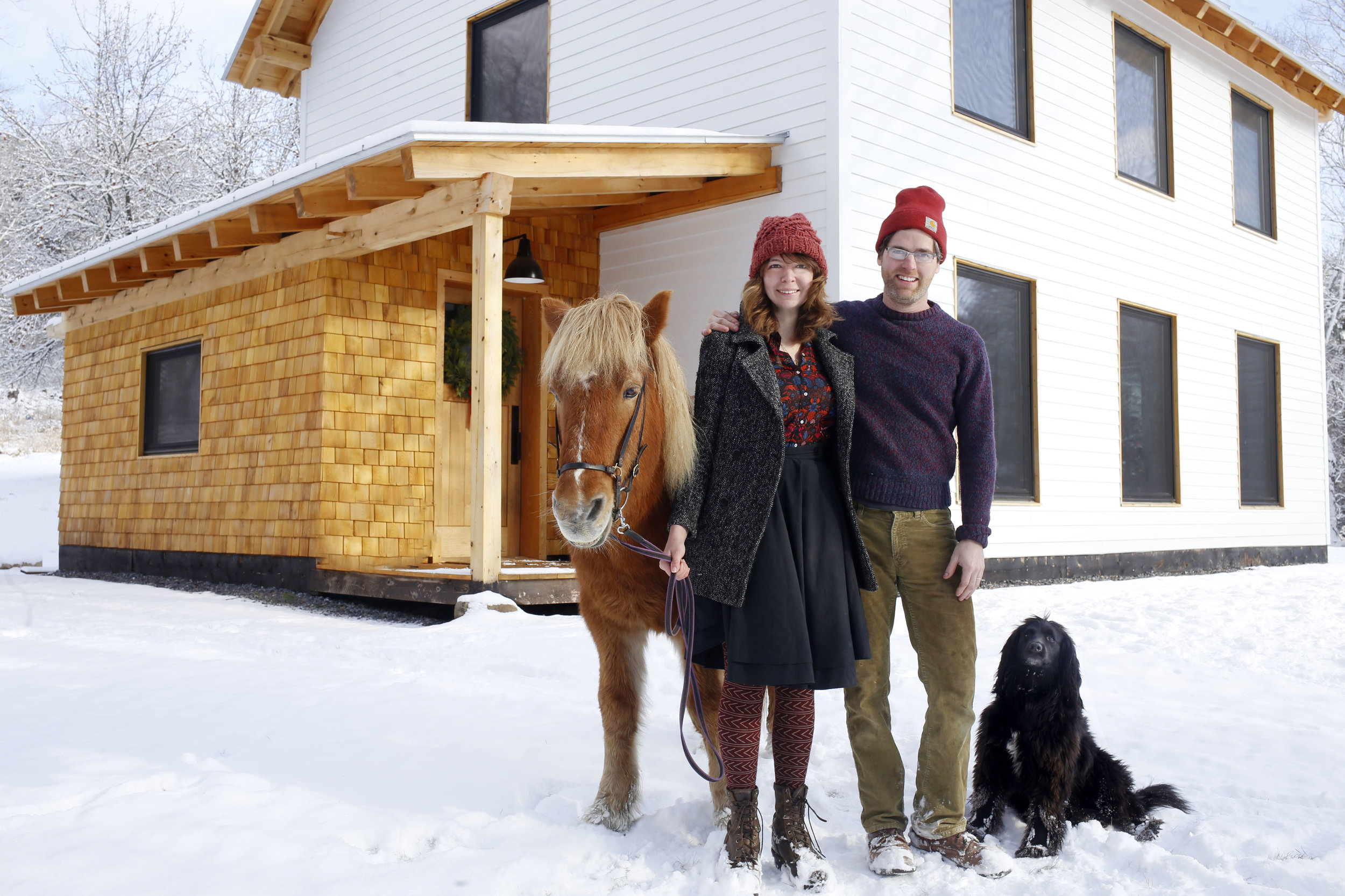 Sarah, Jeff, Glaumur (horse) and Arlo (dog) at our house we built ourselves this year!