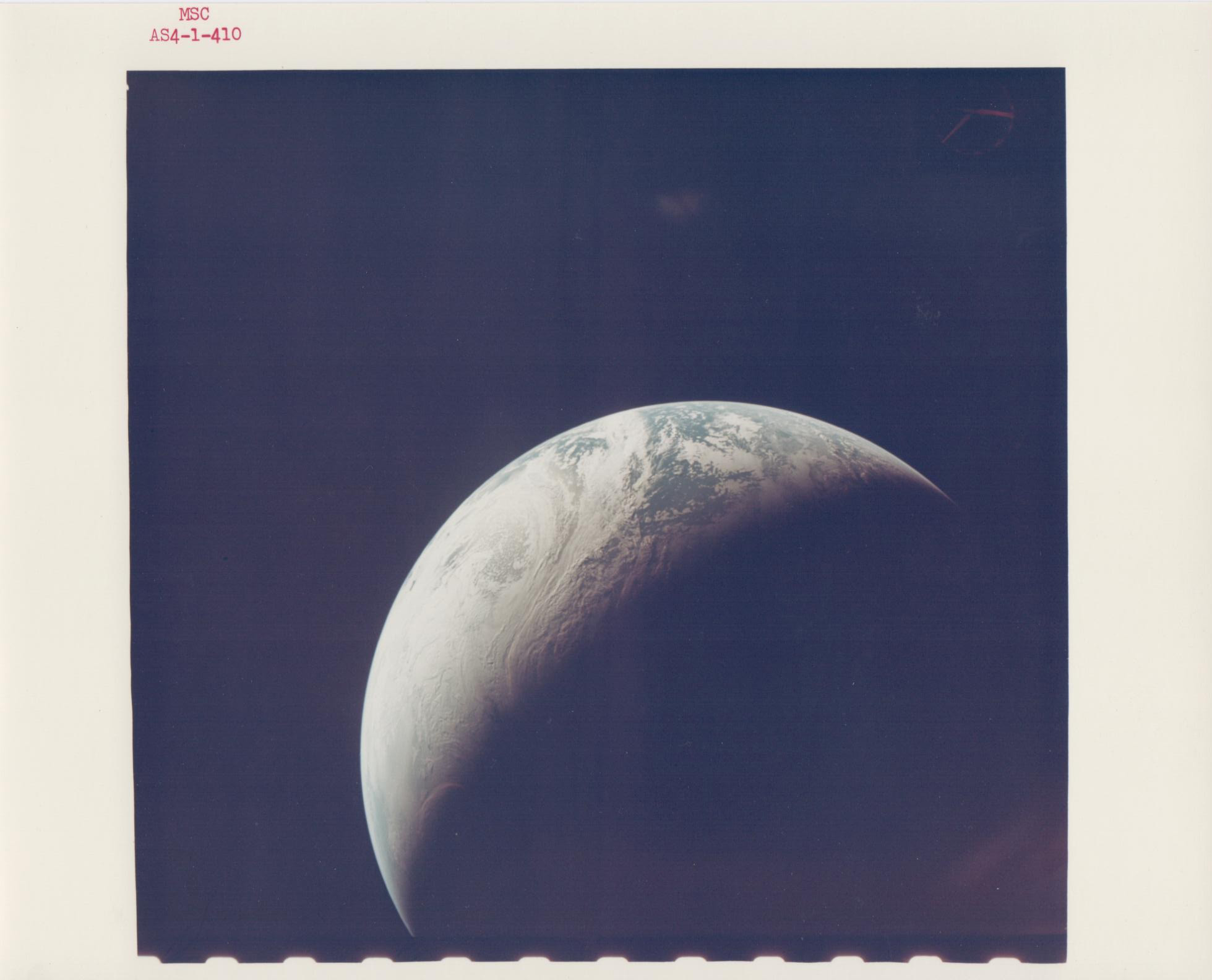 Photo taken 1967 by Apollo 4.  Check out all these other cool space pics too .