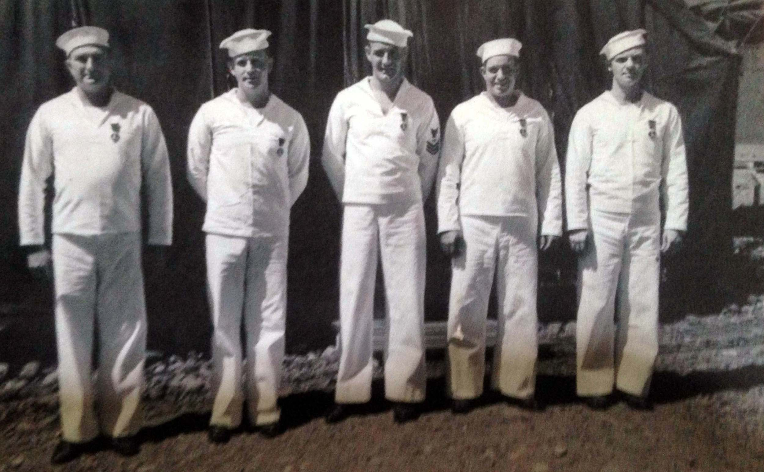 Jack (far right) and his comrades that survived the daisy cutter.