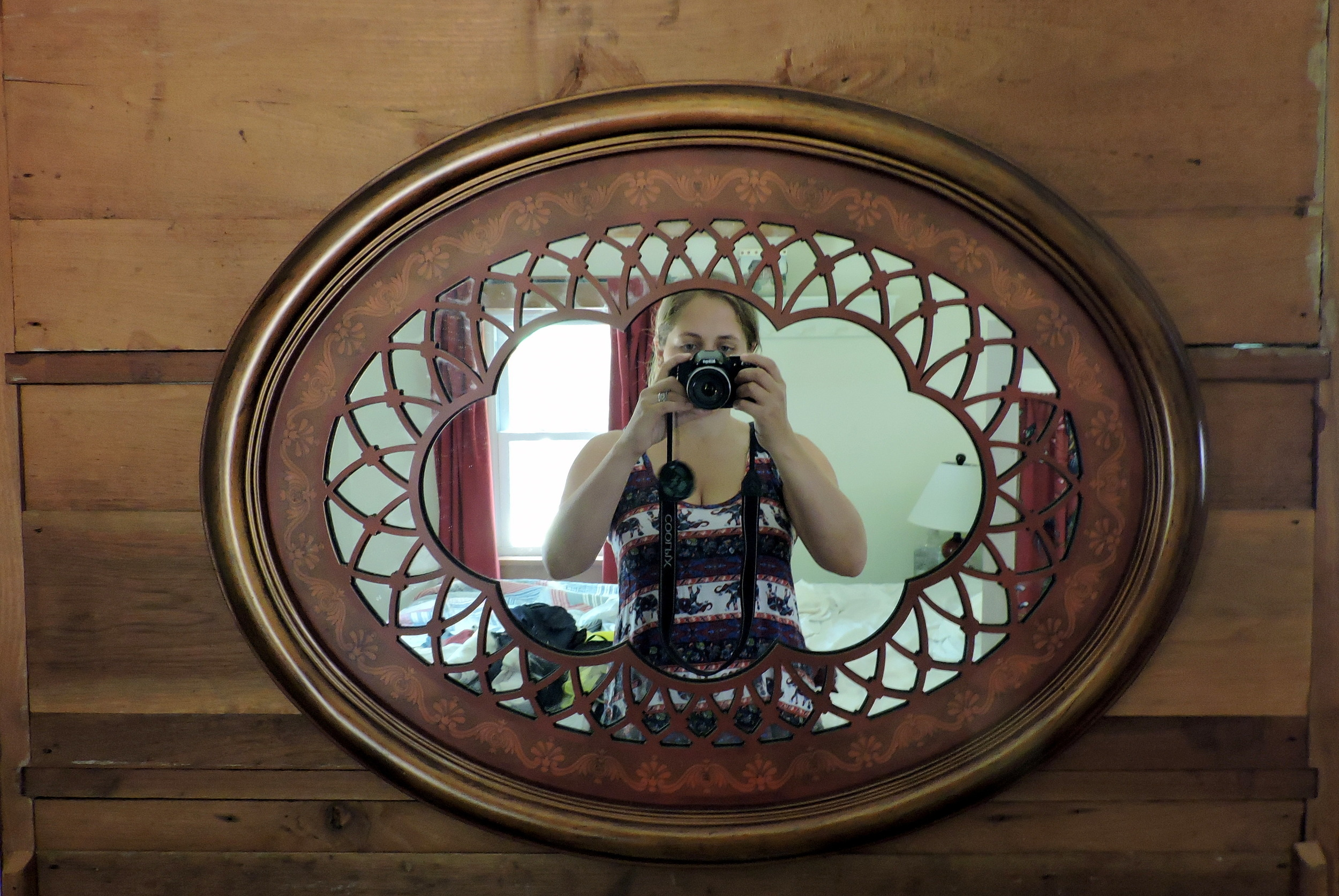 Pictured taking her own picture in the mirror, Ariele is shown here wearing Josh's favorite elephant shirt.