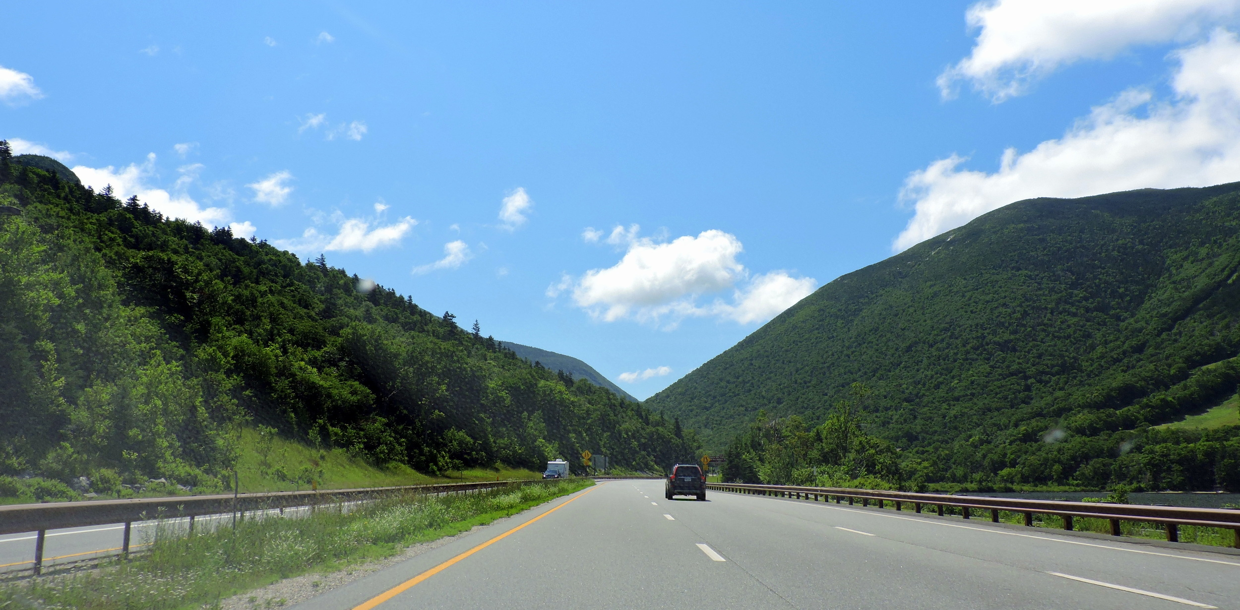 The largest cities along I-93 are Manchester, NH and Boston, MA. It also runs through the NH state capital, Concord.