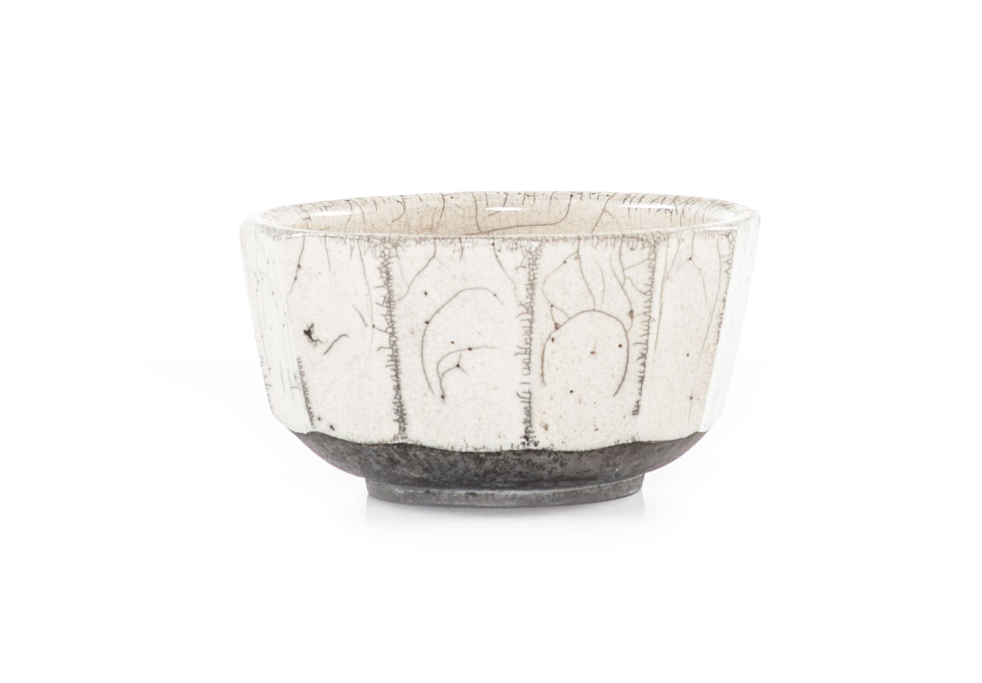 Faceted white raku bowl