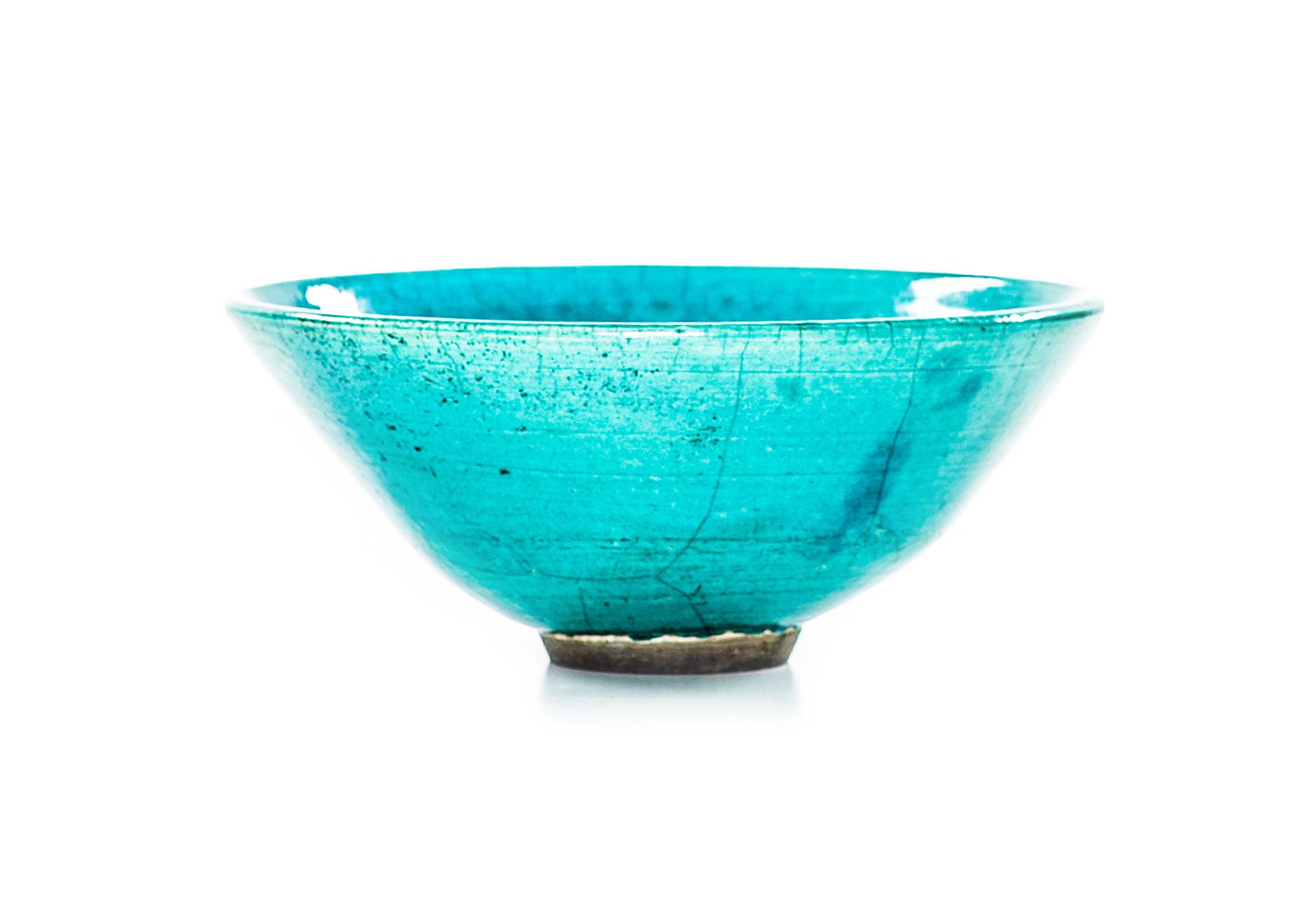 Turquoise raku bowl with copper