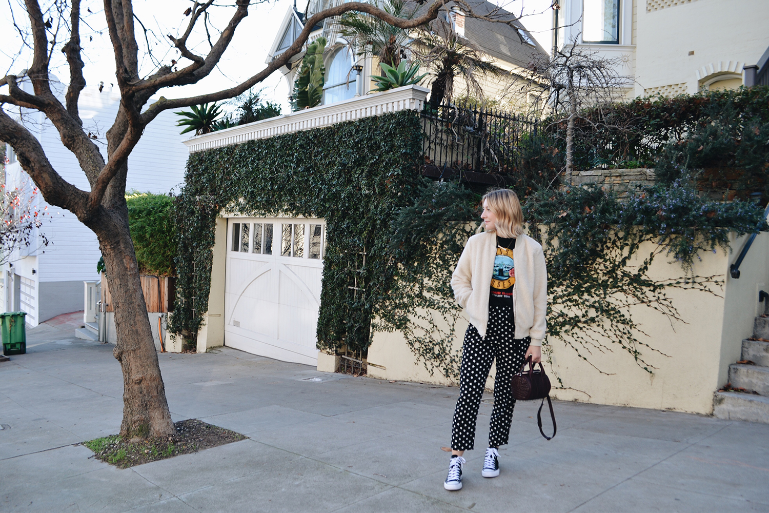 House of Vintage  t-shirt,  J. Crew trousers ,  Old Navy sherpa bomber (on sale), Converse Chuck Taylors ,  Alexander Wang mini rockie