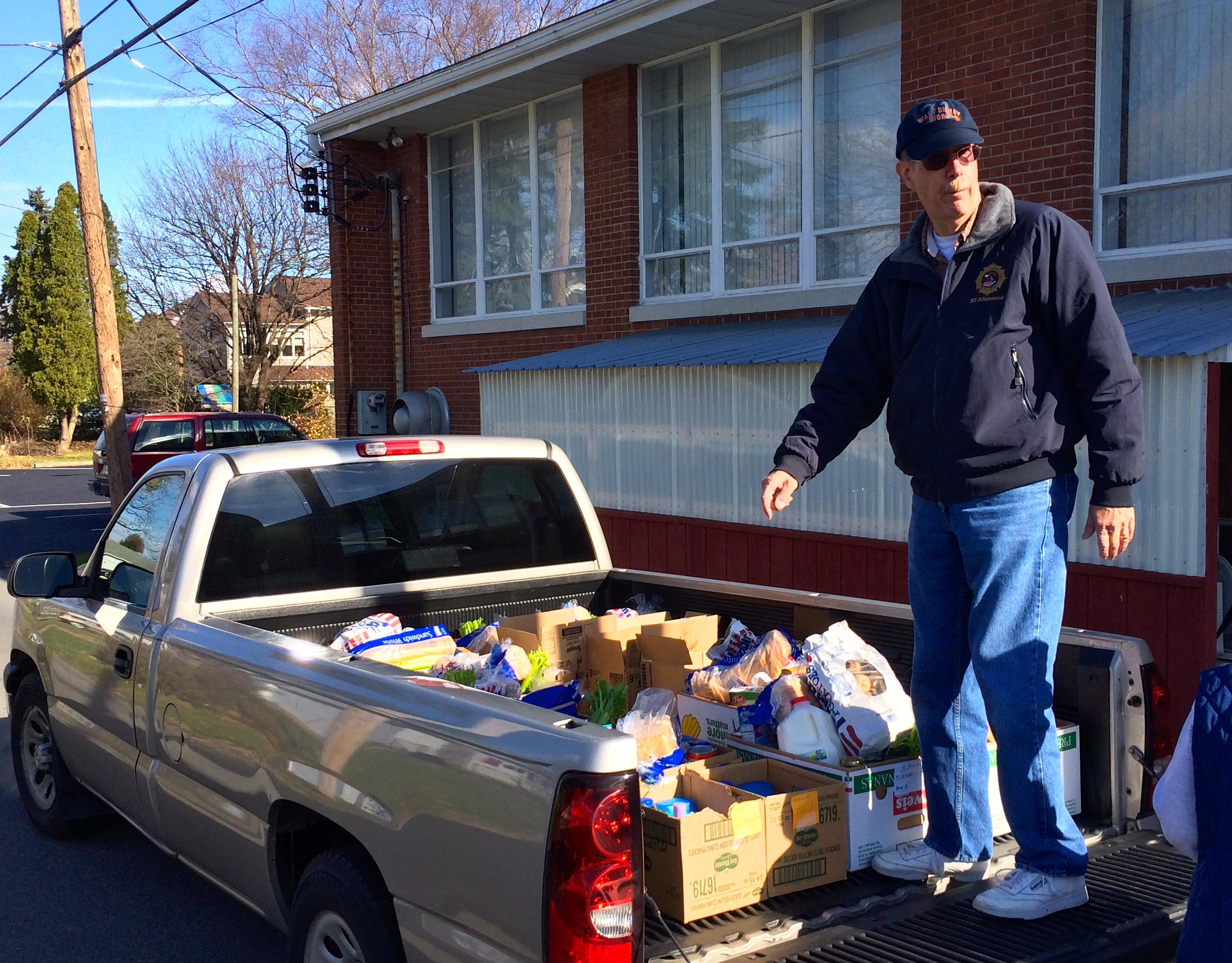 Charlie Ruhl helps transport Holiday Food Baskets