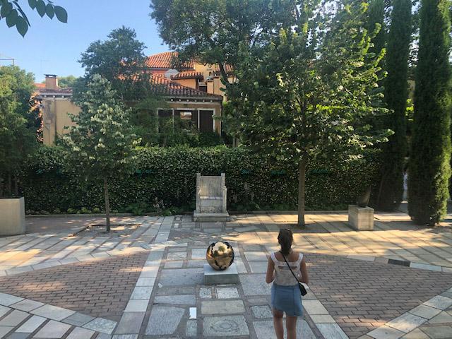 Outside Palazzo Venier dei Leoni with  Sphere No. 4.  by Arnaldo Pomodoro. Bronze and patina. Cast in 1964.