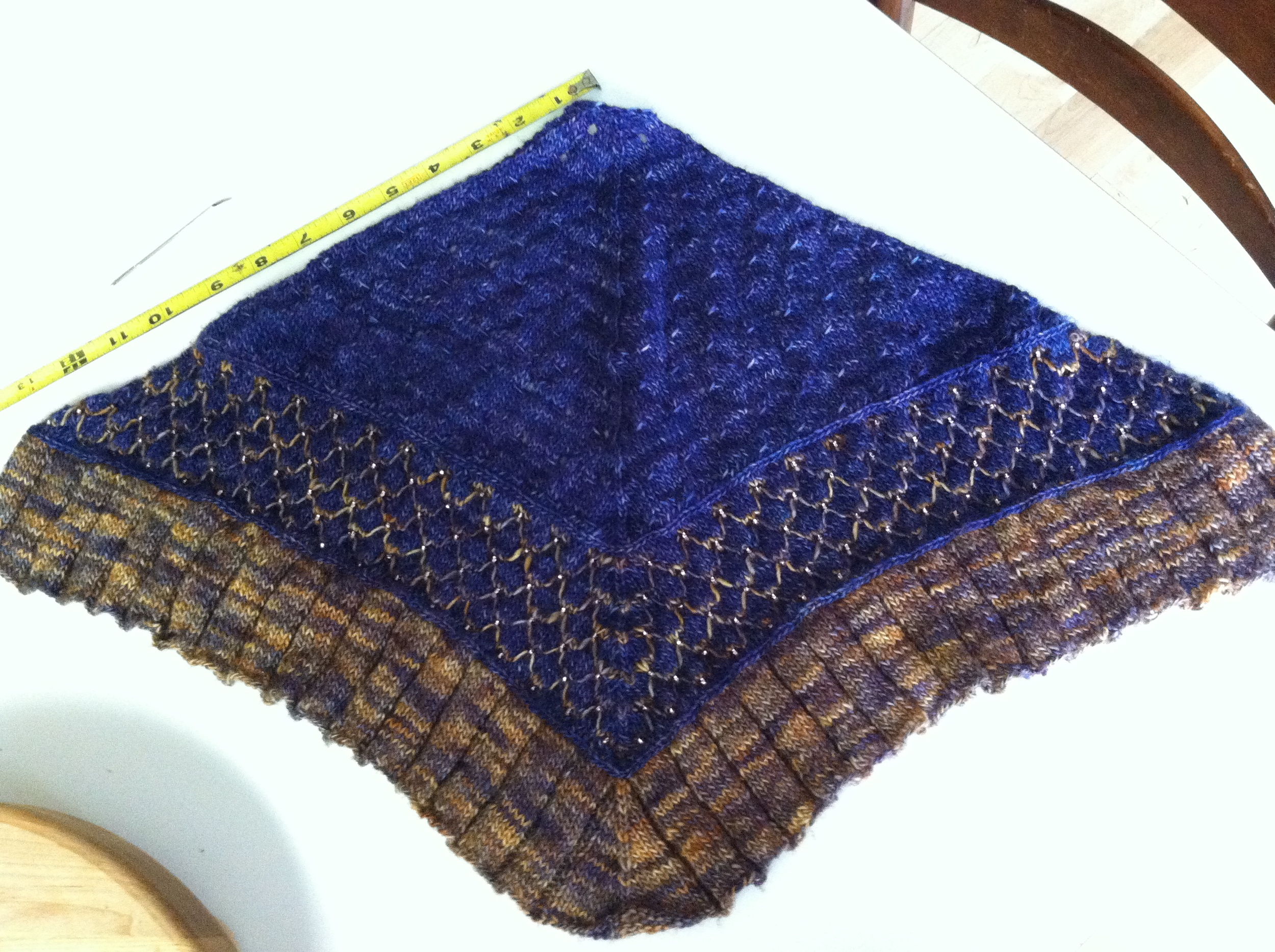 The kercheif before blocking-thought I had blown it but thanks to other knitter's notes in Ravelry website, I persevered and blocked it - measurements are now 38 inches x 16 inches