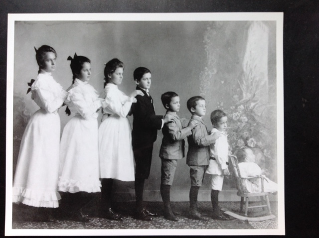 My Grandmother, farthest left, if it were my sisters and I, I'd be the one in the rocking chair.