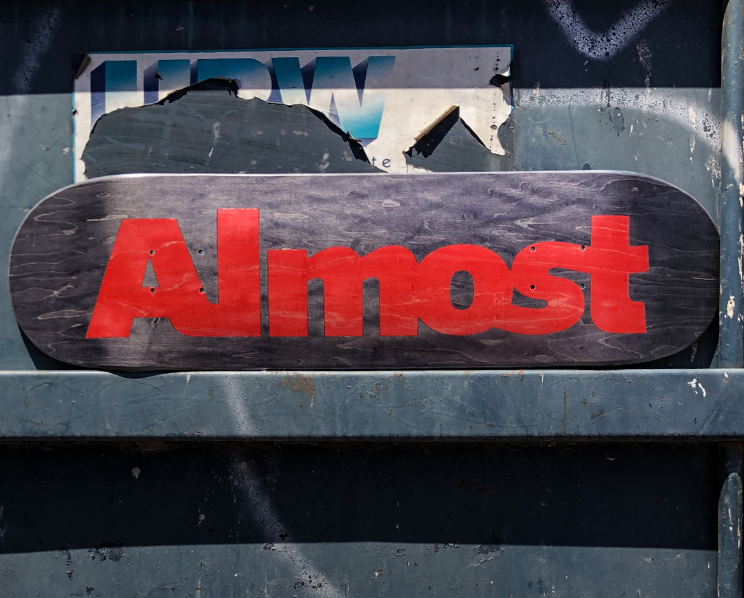Almost Skateboards split veneer ultimate logo.jpg