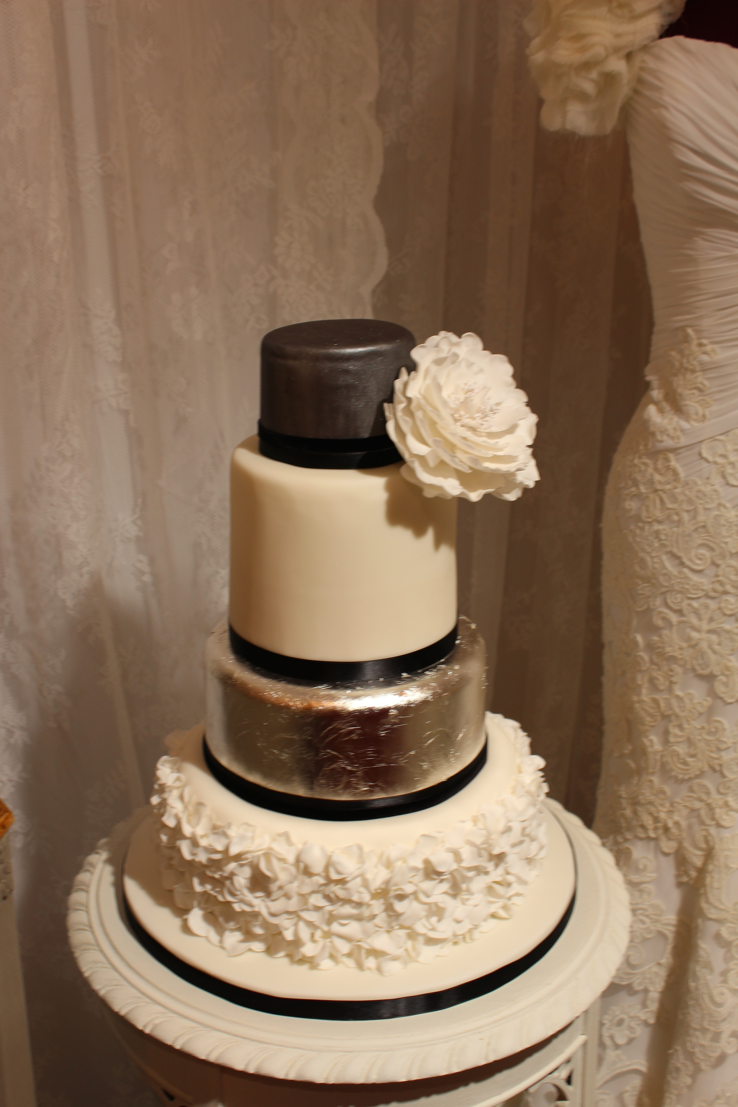 Silver ruffle 4 tier cake with open peony