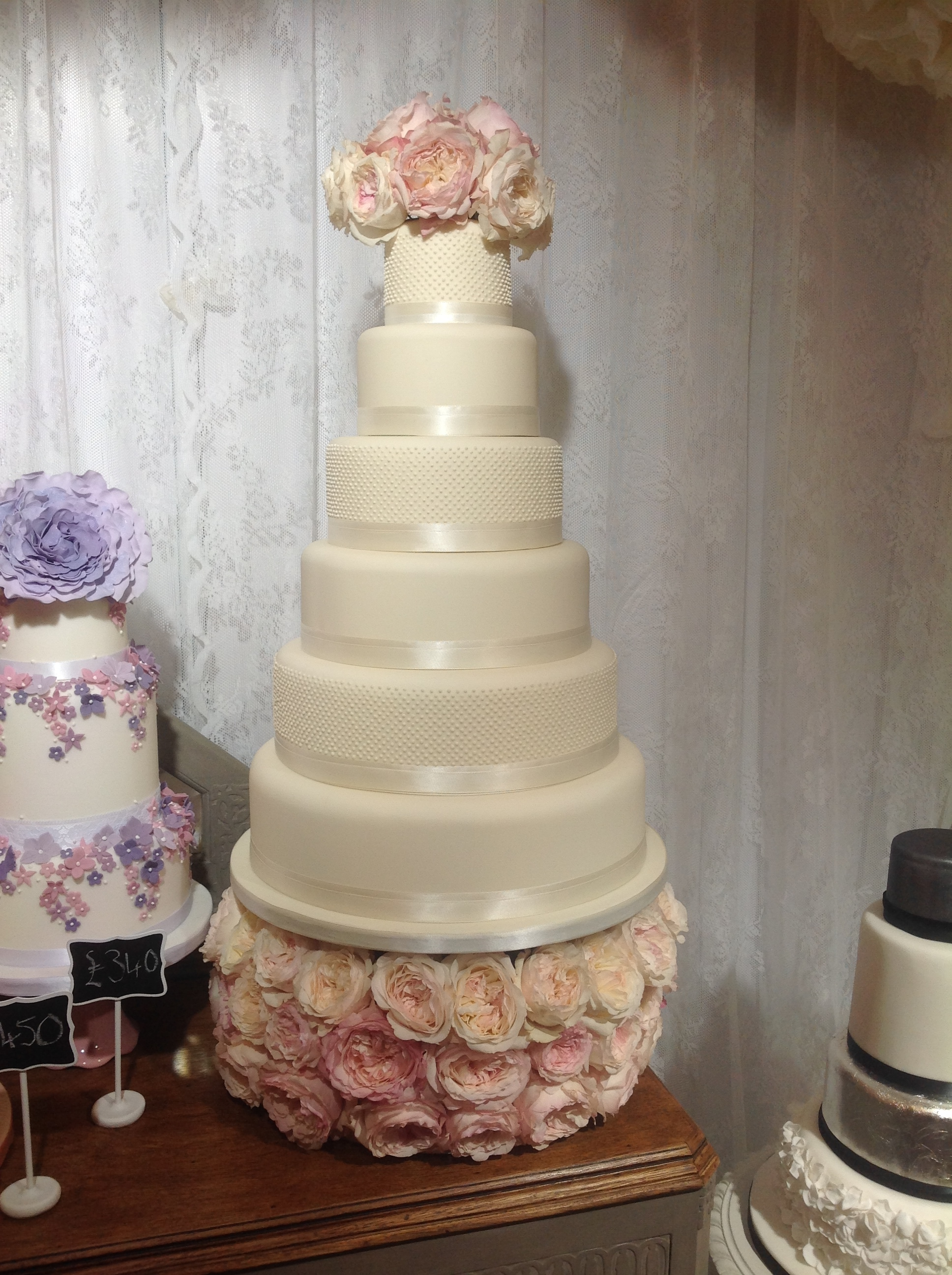Ivory pearl 6 tier cake with David Austin Roses