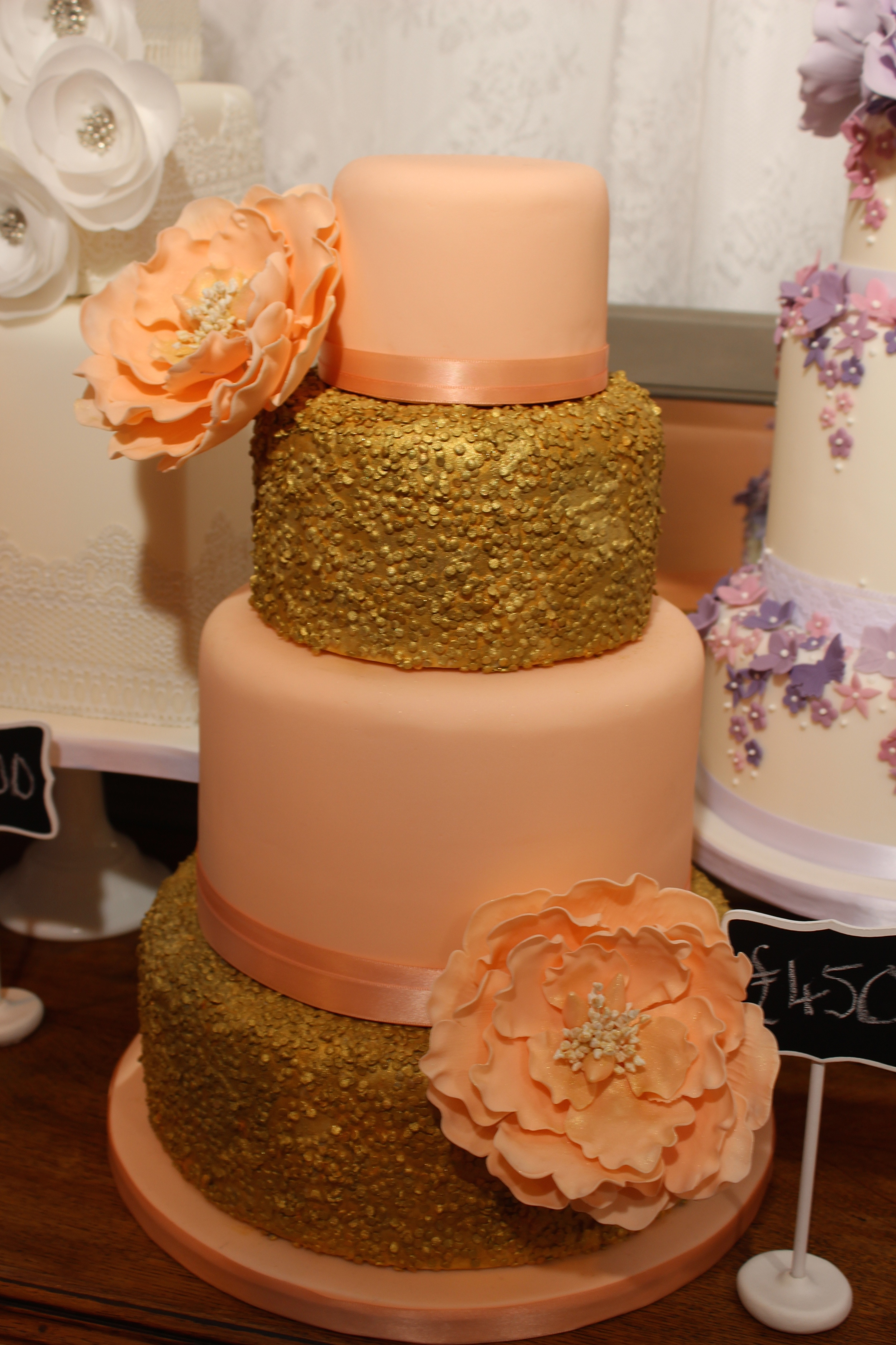 Peach and gold sequin 4 tier cake with open peony