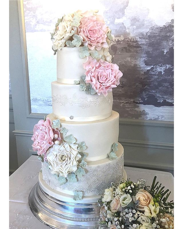 Here's a stunning 4 tier wedding cake we made for a wedding in May. Beautiful handmade roses and edible lace. Each tier was a different flavour. #weddingcake #weddingcake #weddinginspiration #sugarroses #cake #weddings #weddingdesign
