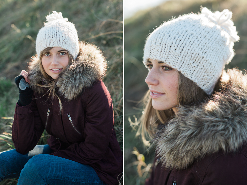 White handknit winter hat with pom pom on model in south portland, maine