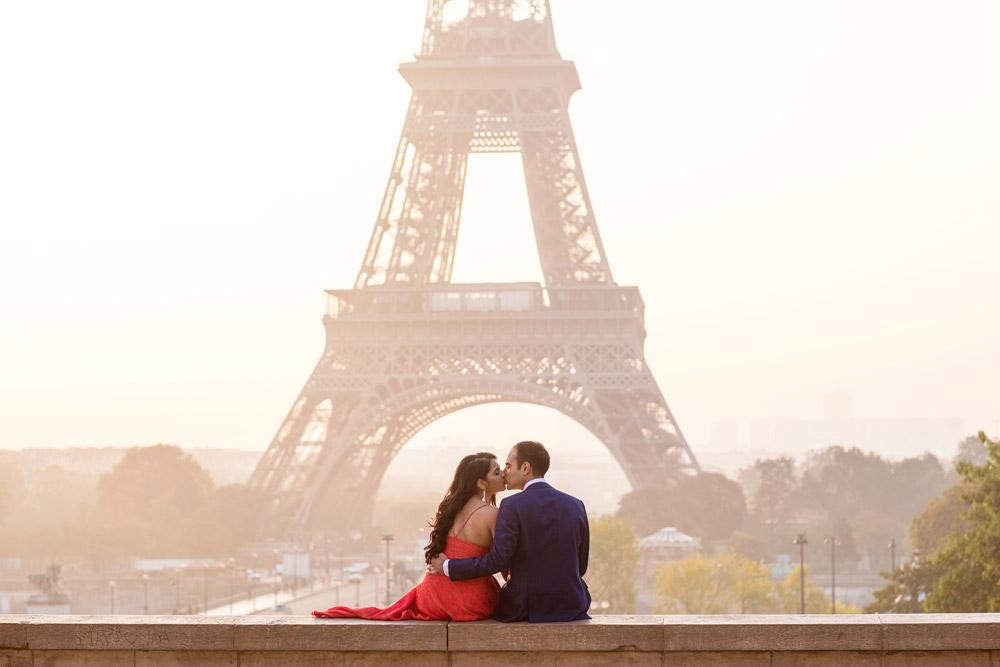 Paris-photographer-Paris-for-Two-Christian-Perona-professional-engagement-proposal-pre-wedding-portrait-Eiffel-tower-golden-hour-sunrise-red-dress-kissing-Trocadero.jpg