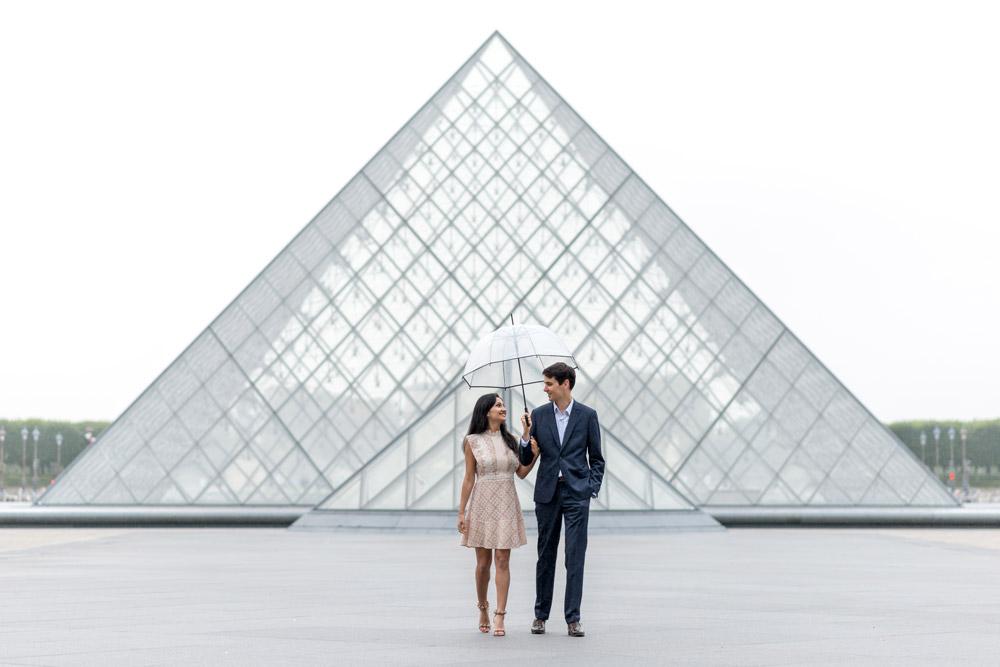 Paris-photographer-Paris-for-Two-Christian-Perona-professional-engagement-proposal-pre-wedding-portrait-Louvre-Museum-sunrise-rain-rainy-day-umbrella-side-by-side.jpg