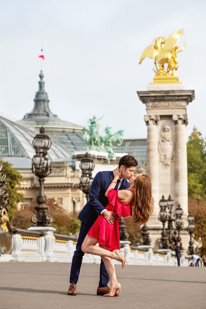Paris-photographer-Paris-for-Two-Christian-Perona-engagement-red-dress-blue-vay-suit-love-pre-wedding-proposal-shoot-photoshoot-Alexander-Alexandre-III-bridge-depp-kiss-Grand-Palais.jpg