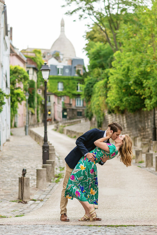 Paris-photographer-Christian-Perona-engagement-she-said-yes-love-Montmartre-cobblestones-street-sacre-coeur-basilic-church-deep-kiss.jpg