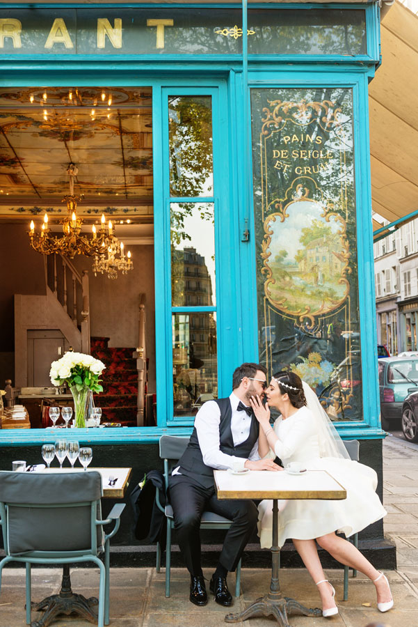 Paris-photographer-Christian-Perona-wedding-gown-groom-bride-yes-love-kissing-Cafe-Bistro-Restaurant.jpg