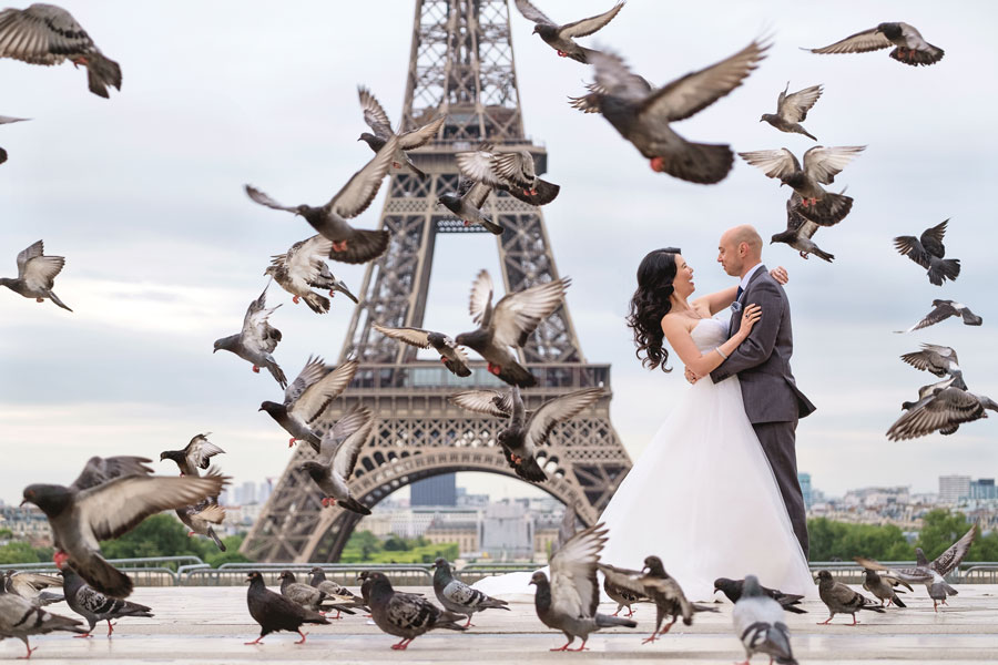 Proposal-photographer-in-Paris-Christian-Perona-sunrise-Trocadero-Eiffel-tower-she-said-yes-wedding-couple-stairs-dress-birds-gown-groom.jpg