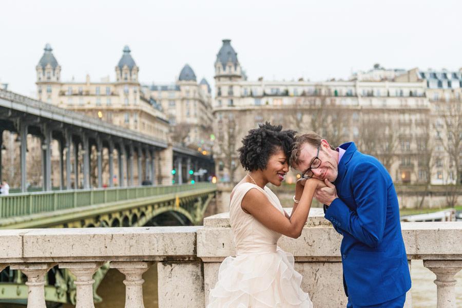 Photographer-Paris-Christian-Perona-elopement-smiling-kissing-Bir-Hakeim-she-said-yes-blue-suit.jpg