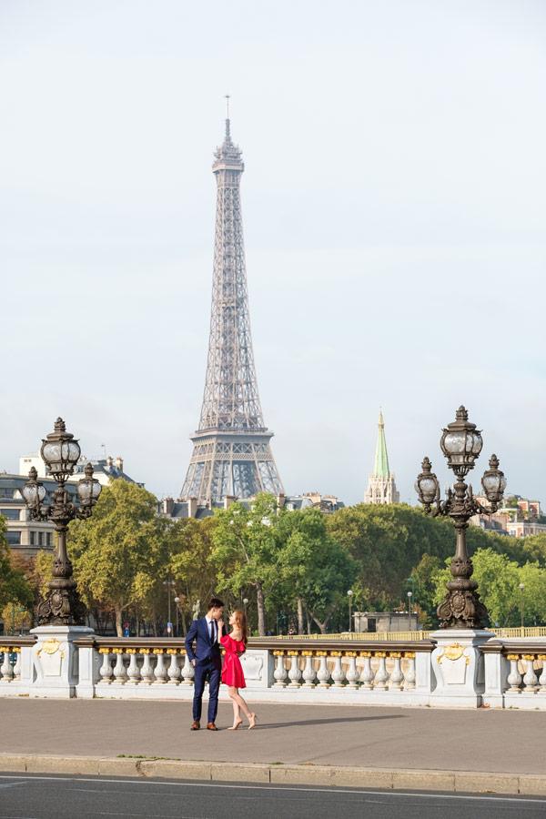 paris-photographer-christian-perona-professional-engagement-proposal-pre-wedding-portrait-Alexandre-III-bridge-pont-Eiffel-tower-red-dress.jpg