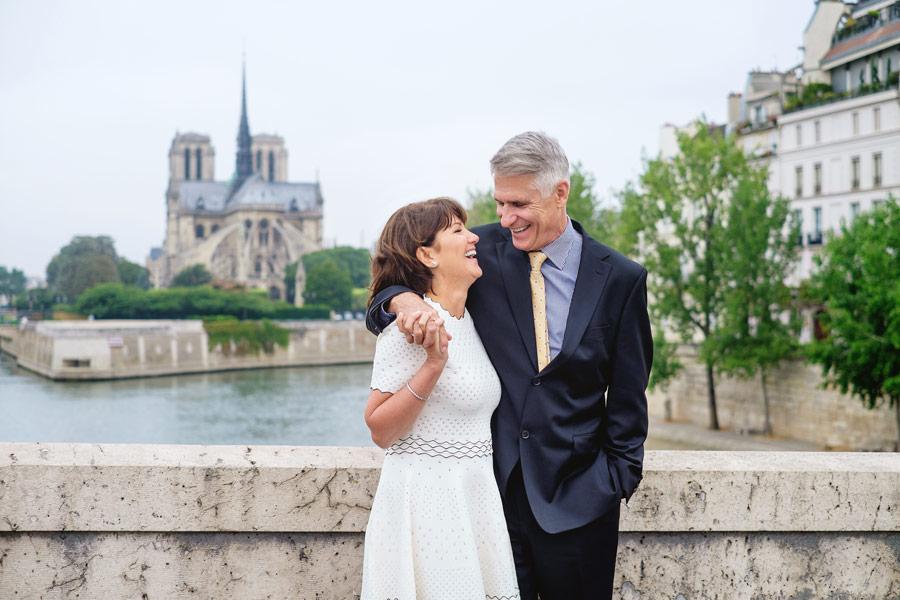 Paris-photographer-Christian-Perona-wedding-anniversary-smiling-Notre-Dame-Cathedral.jpg