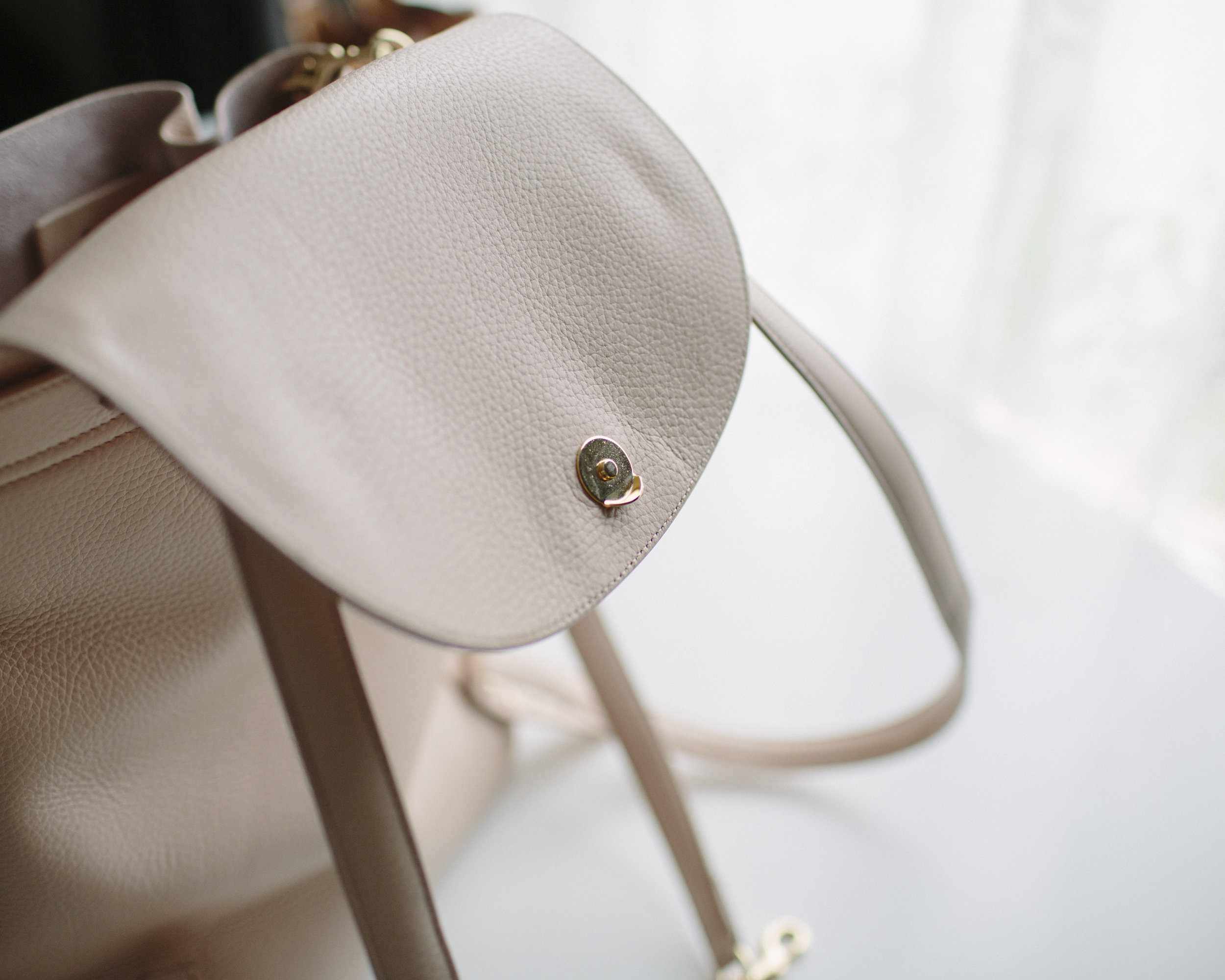The lip on the closing clasp helps the bag stay closed better.