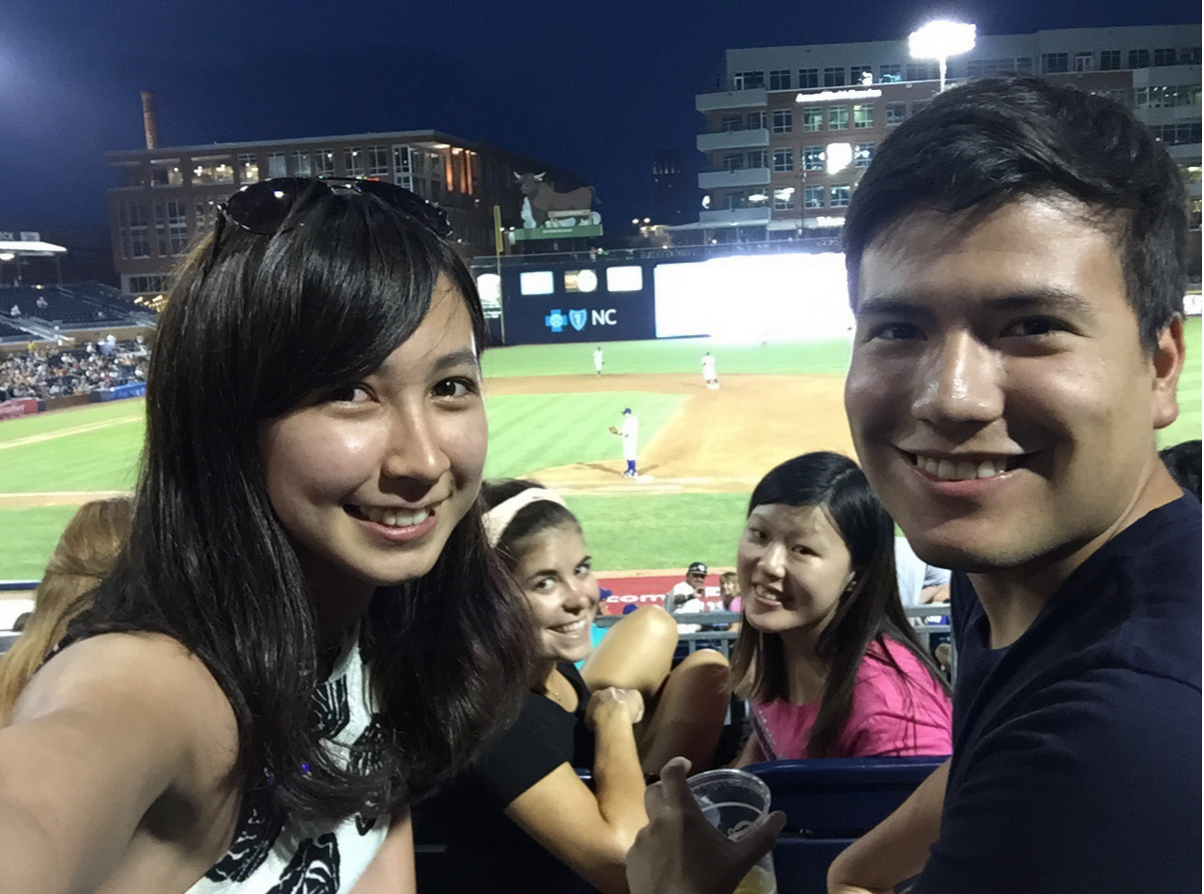 Experience THE USA Official pass time!  MQ Students Rhiannon and Sarah enjoy a game of baseball. Go Durham Bulls!