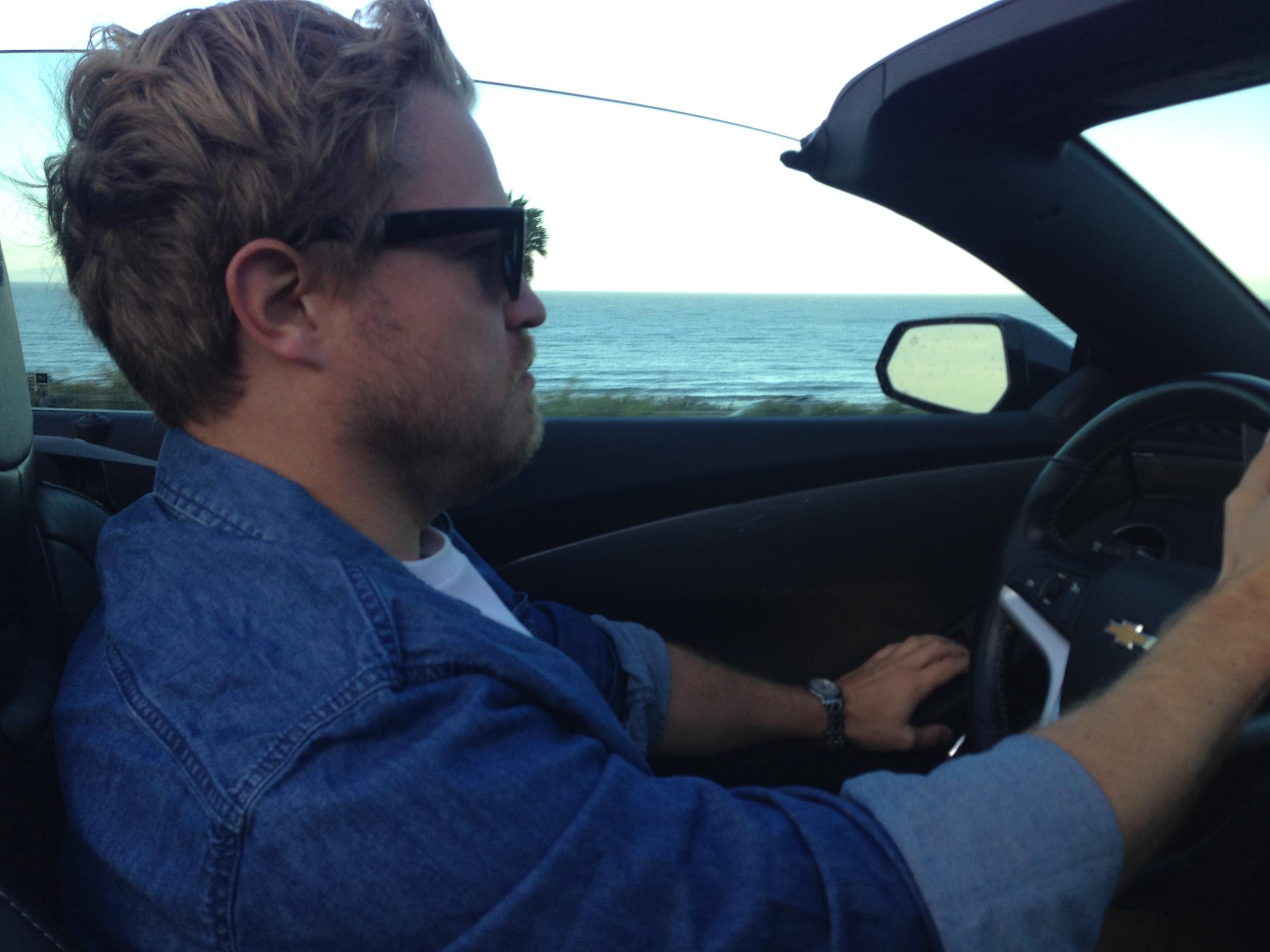 (Mr Jackson, aka prince charming, driving a convertible up the California coast.)