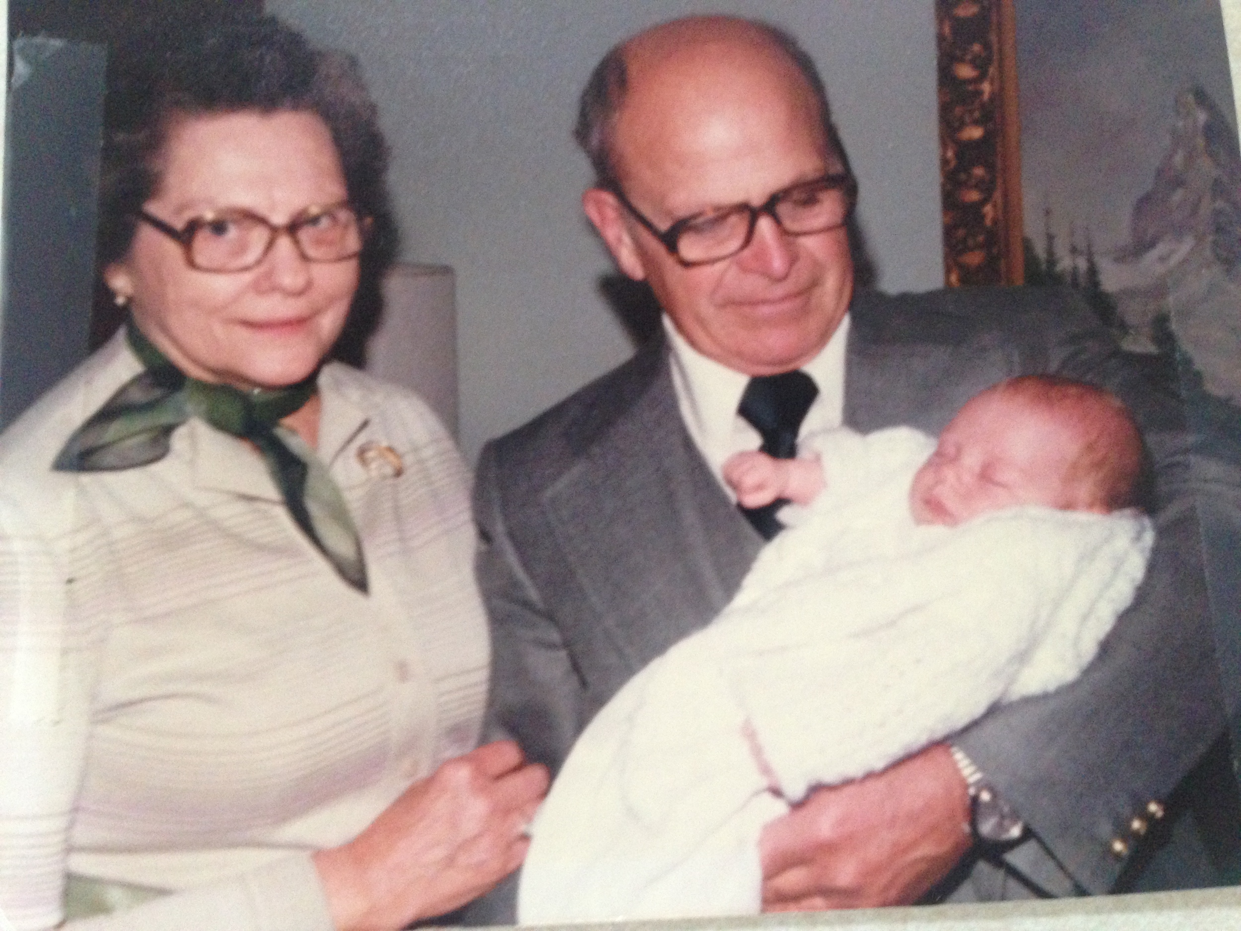 My grandpa holding me with my grandma looking on.