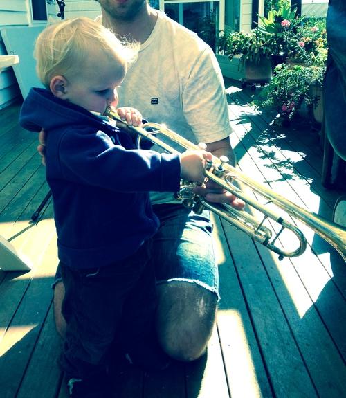 Joseph playing my trumpet.jpeg