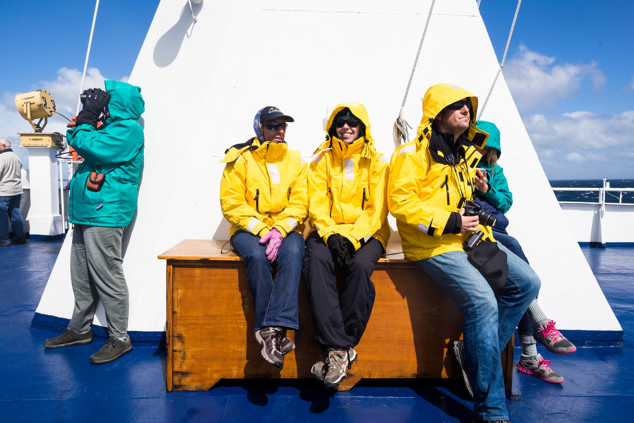 New friends relaxing on the upper deck as we round Cape Horn, heading home.