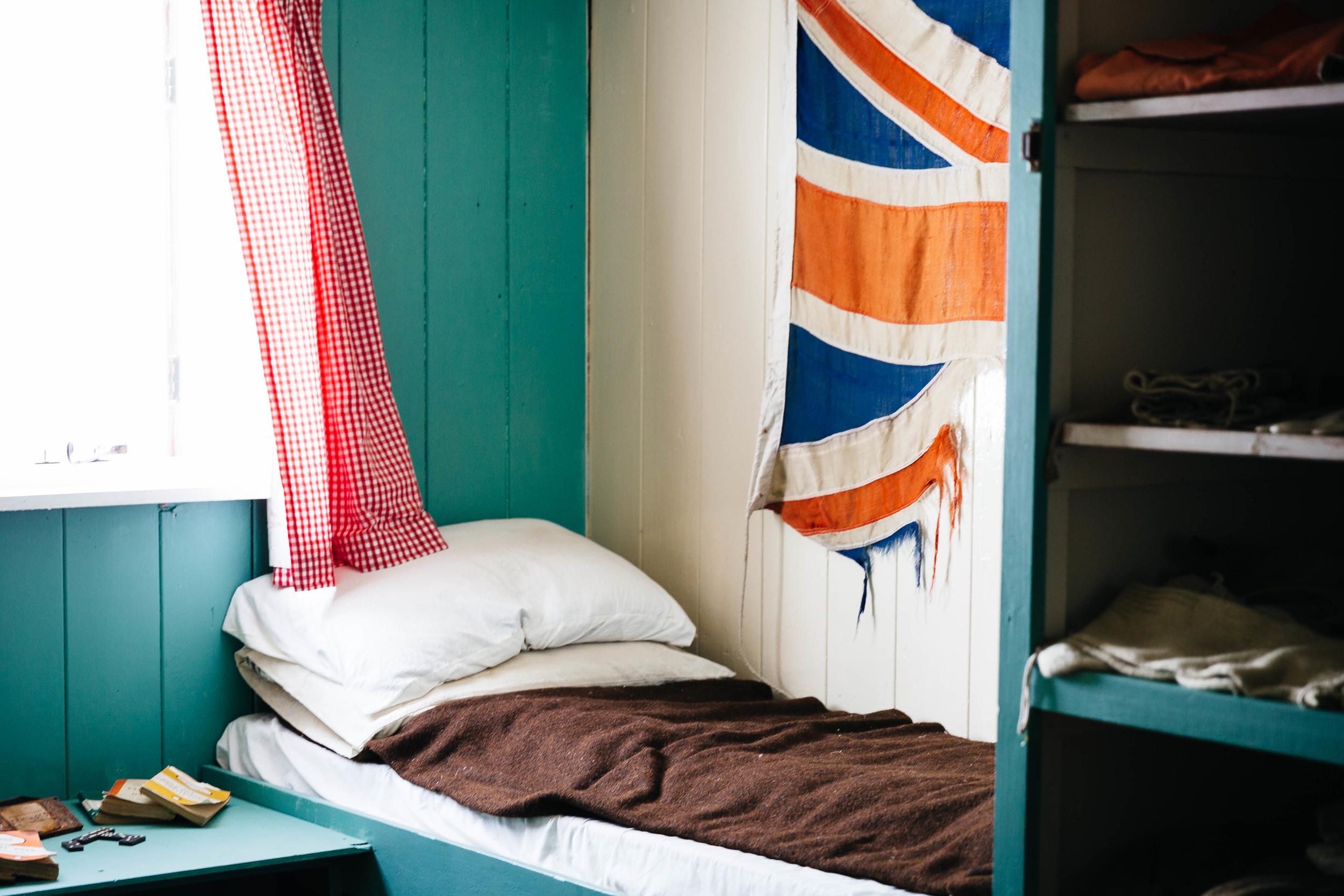 Preserved sleeping quarters of British explorers display at the  Port Lockroy museum.