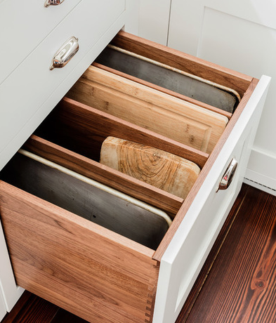 How nice would a drawer like this be?! No more loud noises and fighting cookie sheets--it's just all separate and organized and tucked away neatly!